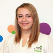 A smiling Tara a certified technician at lice clinic lexington